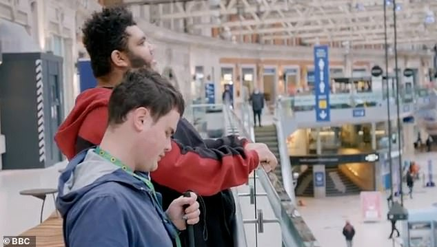 Fan: Harvey's love of trains was evident in the documentary as he and his friend Jack watched trains in and out of Waterloo Station.