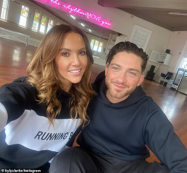 Mates:u00A0Kyly appears to have otherwise been having a ball in the company of her hunky Italian dance partner, Gustavo Viglio (right). The former WAG was beaming as the pair cuddled up for a sweet selfie earlier on Sunday