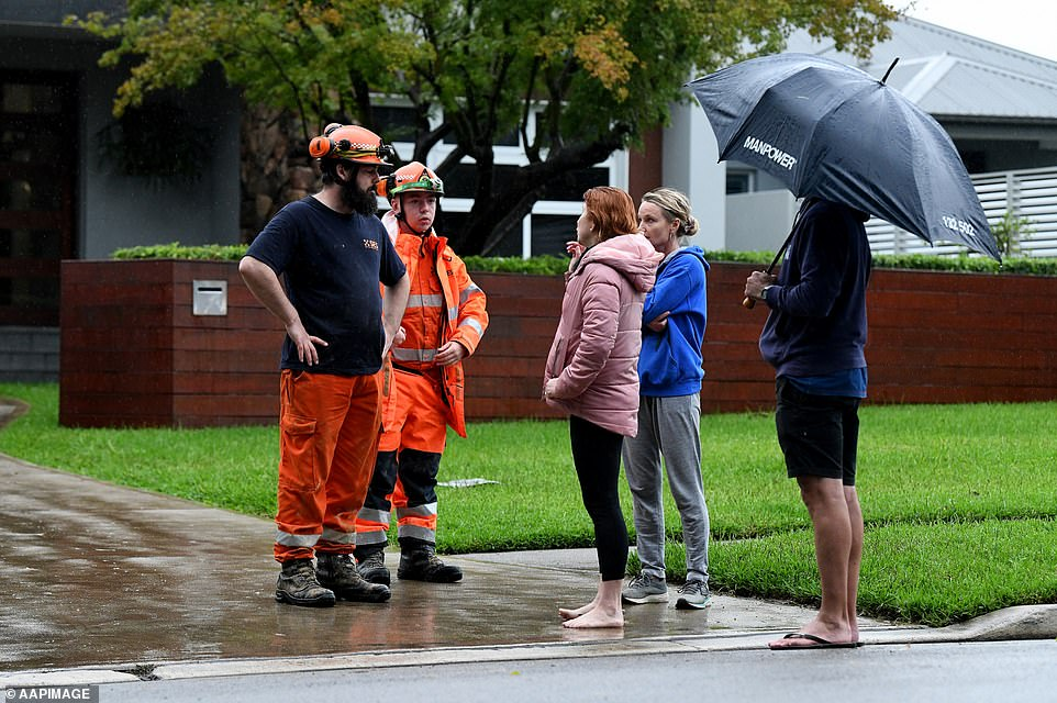 Residents in western parts of Penrith were ordered to evacuate by SES volunteersu00A0 on Sunday afternoon before flood levels rise. Pictured are residents inu00A0Ladbury Ave, Penrith.