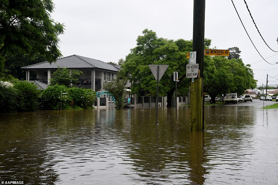 The corner of Ladbury and Memorial Ave Penrith (pictured) is now underwater, forcing local residents to evacuate