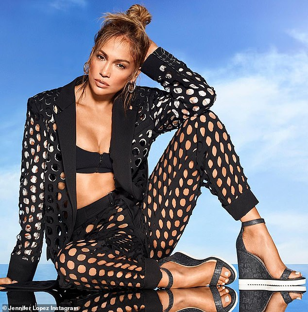 New look:u00A0Jennifer Lopez posted two sizzling hot photos to Instagram on Sunday where she was dressed up to impress