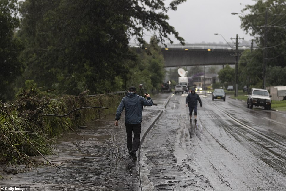 Flood damage is seen on the road in Penrith, western Sydney, after a weekend of wild weather