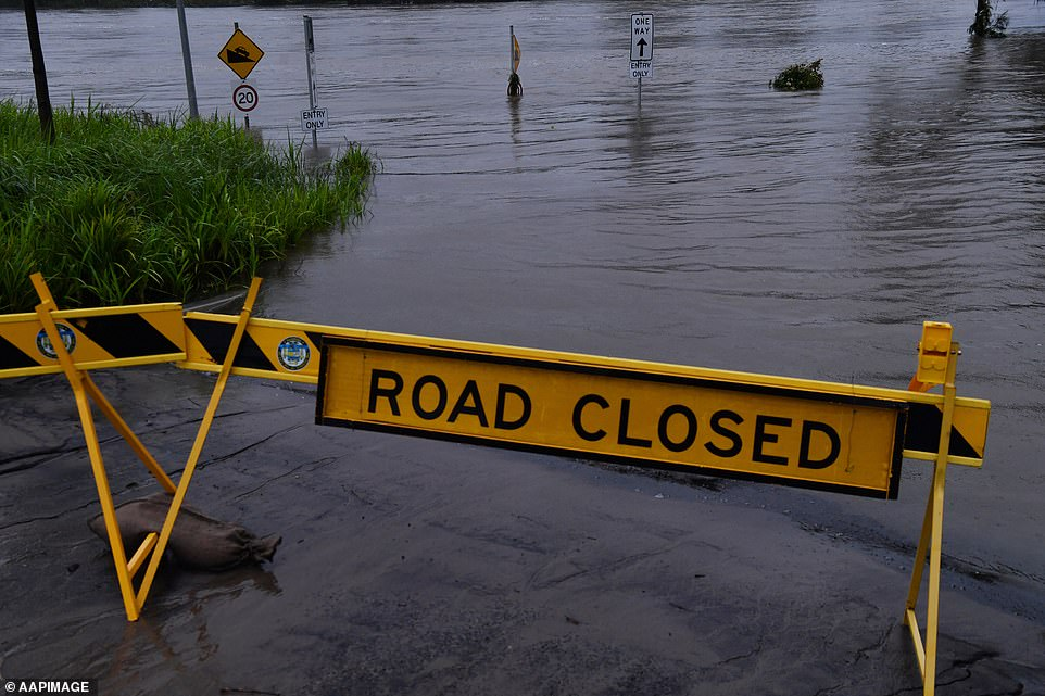 A 'road closed' sign is displayedu00A0at Trench Reserve in Penrith on Monday, as thousands of residents are fleeing their homes and schools are shut