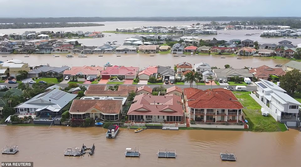 Thousands of families face losing their homes and many others spent a sleepless night in evacuation centres as a rain-soaked NSW prepares to be battered for another wave of torrential rain. Port Macquarie is pictured above