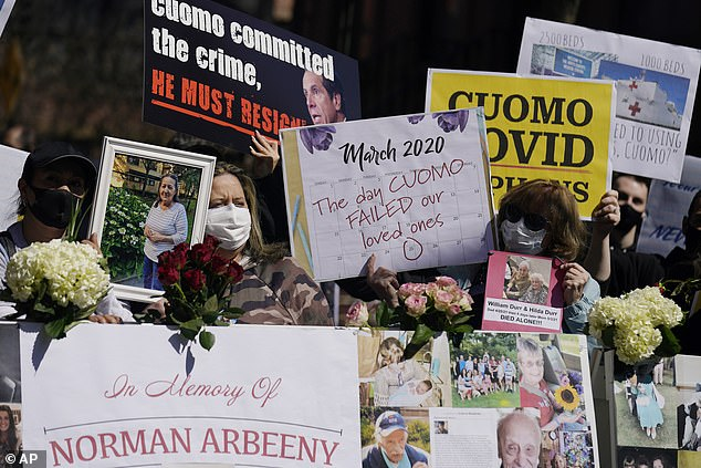 People pasted pictures of their loved ones - and many held signs calling for Cuomo's resignation