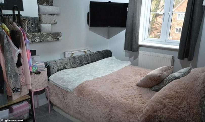 Double bedroom: The spare room is being used by Katie as a place she can keep some of her clothes that include pink hoodies and a tie dye jacket– but lacks additional storage space