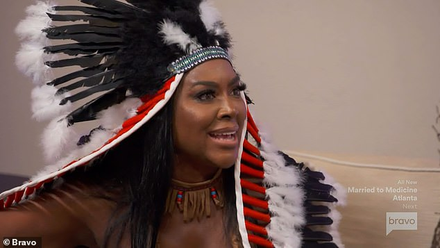 Poor form: Kenya Moore has apologized for her 'disrespectful and insensitive' Halloween costume after being accused of cultural appropriation for dressing in a headdress and generic 'Native American' attire during the latest episode of the Real Housewives of Atlanta
