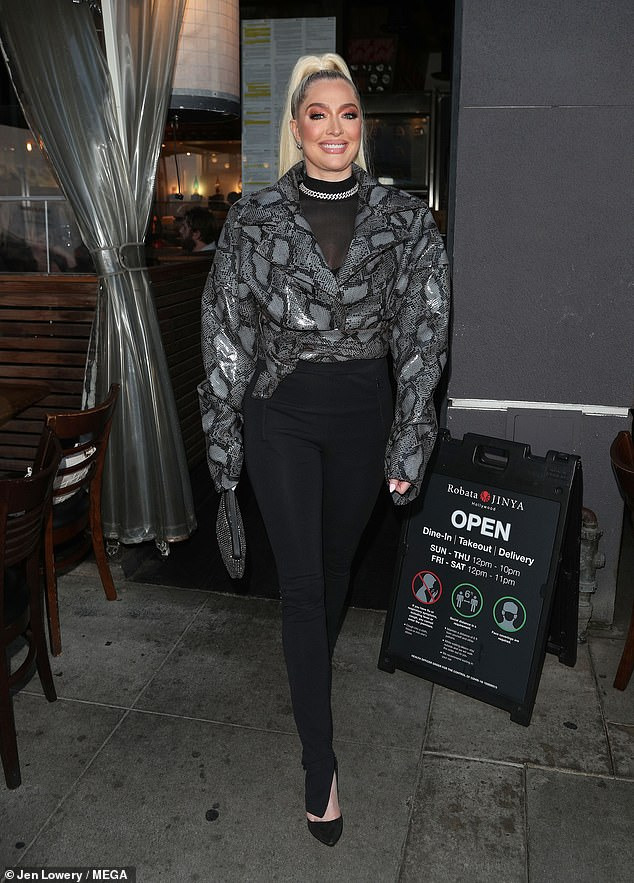 You glow girl! Jayne radiated confidence in a snakeskin jacket with tight black pants, a sheer top and chain choker as she sauntered out of the restaurant in Louboutin heels