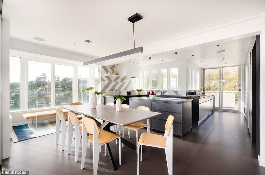 There's an upscale modern kitchen and a dining area