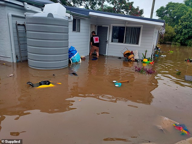 Family lost almost everything when their new house was destroyed by floodwater (pictured)