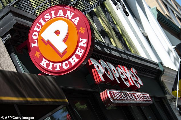 A Popeyes fast food chain restaurant is seen on a street of Washington DC in August 2019