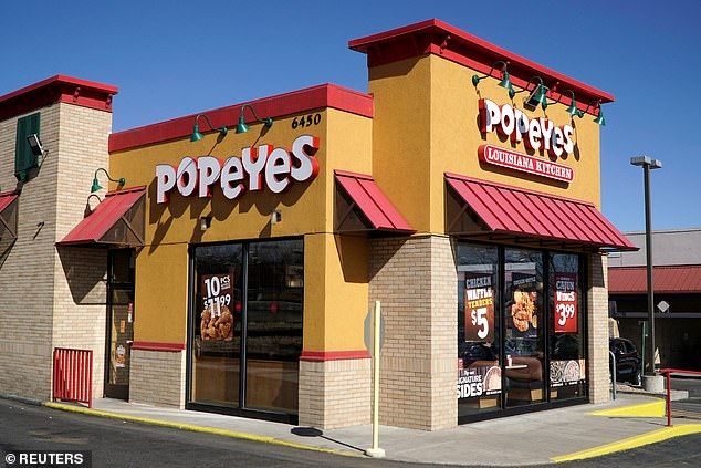 US fried chicken chain Popeyes will launch its first restaurant in Britain by the end of this year, it announced today. One of the firm's restaurant is pictured in Westminster, Colorado, in 2017