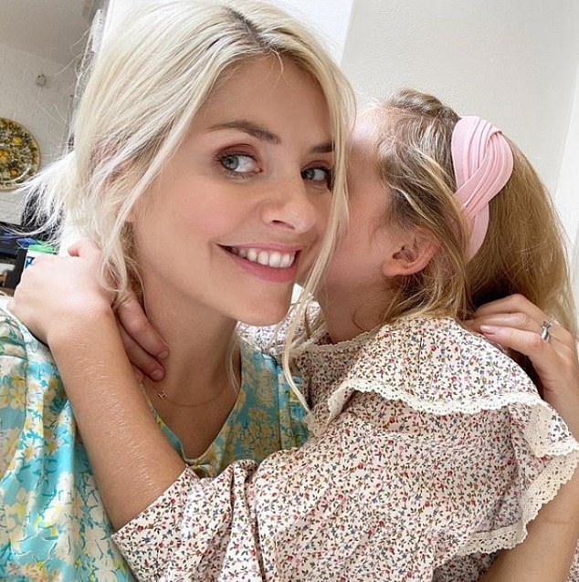 Support:Holly Willoughby has revealed that socialising with other parents at 'mum groups' was one the 'most important' things that helped her as a new mother (pictured with daughter Belle, nine)