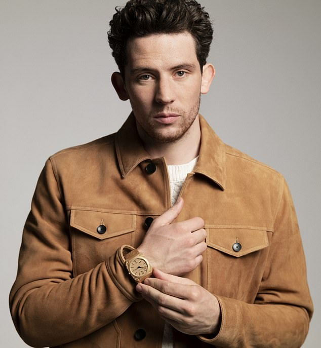 Smouldering: Josh goes for a lighter look in another snap, this time in a cream sweater and tan suede jacket