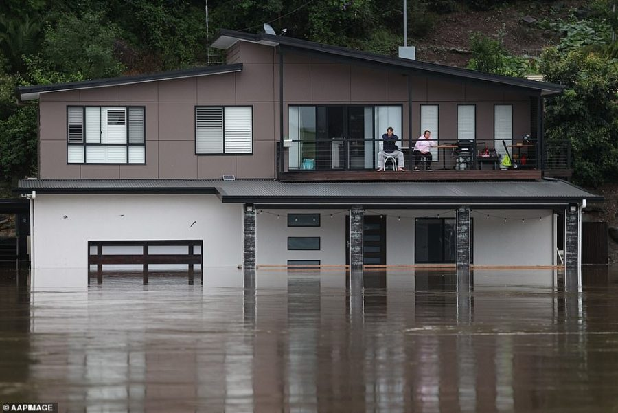 Floods not seen since the 1961 disaster have devoured hundreds of homes and forced thousands to evacuate between Sydney and Byron Bay after five days of torrential rain