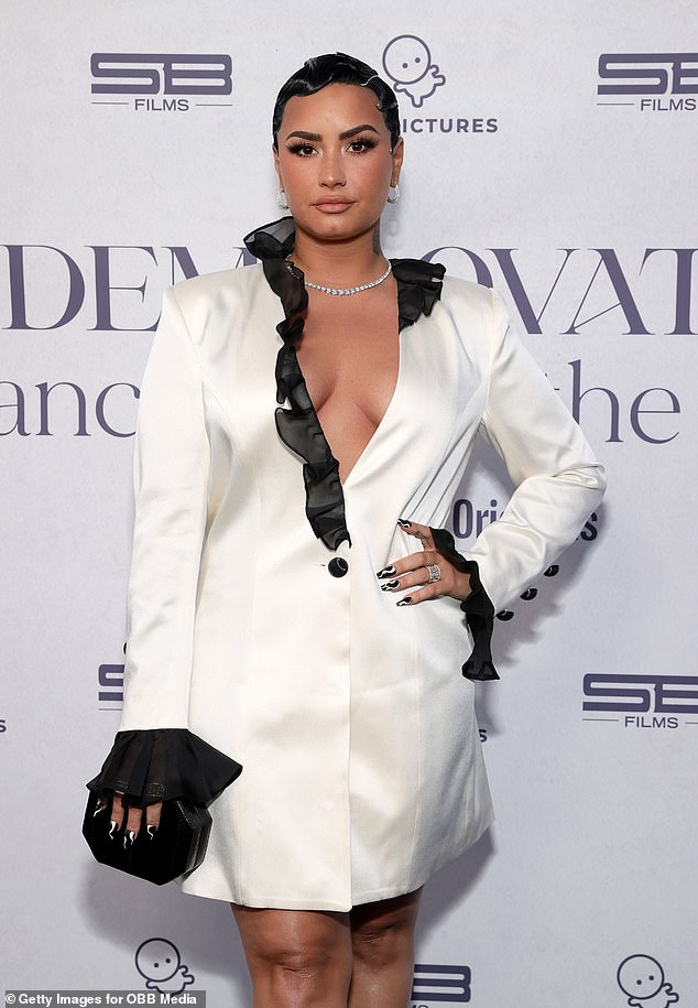 Survivor: Demi bravely shares her experience as a sexual assault survivor in the Michael D. Ratner-directed docu-series, where she publicly reveals that she lost her virginity when she was raped at age 15.  She was seen at the Monday night premiere above