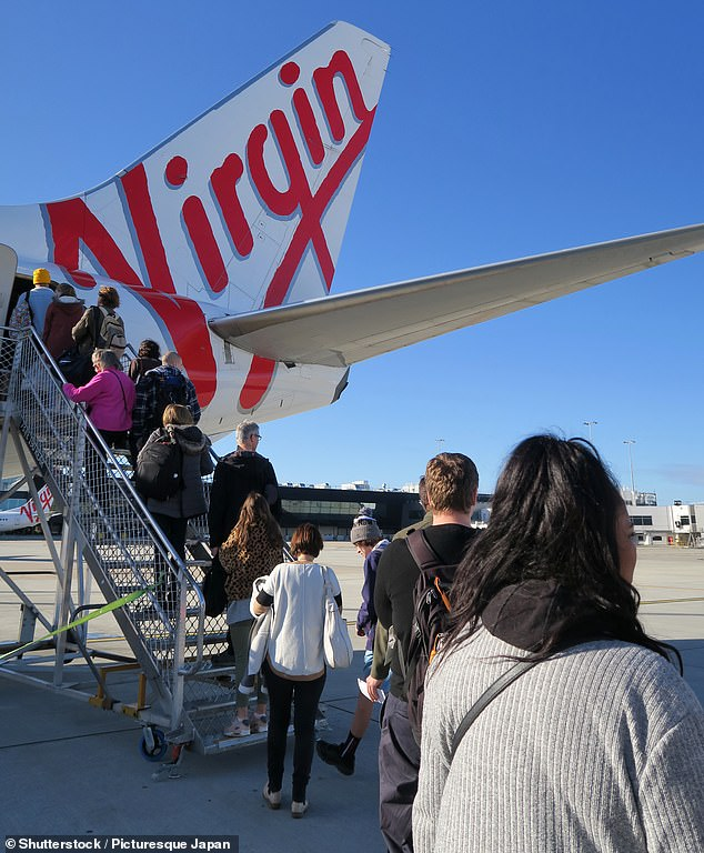 The company sent out an email to their customers on Wednesday informing them of the new policy (pictured: passengers boarding the plane)