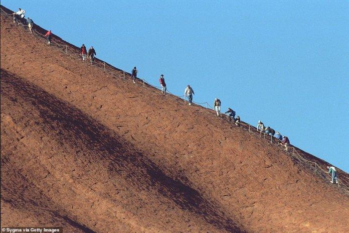 Thousands of tourists flocked to Uluru for the last chance to climb Uluru