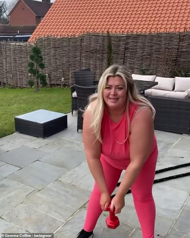 Glowing: She looked happy an healthy in the short Instagram video where she completed her look with matching pink sports leggings and black trainers