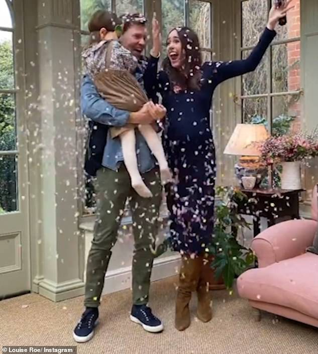 Big sister to be!The toddler was soon all smiles again as her parents threw her into the air in celebration of the happy news