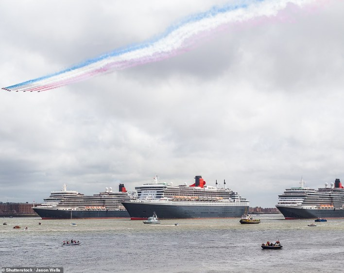 The Red Arrows fly over the three Queens of the Cunard fleet - Mary 2 (centre), Elizabeth and Victoria - on May 25, 2015, as they mark Cunard's 175th anniversary with a formation sailing on the River Mersey in Liverpool, where Cunard was founded