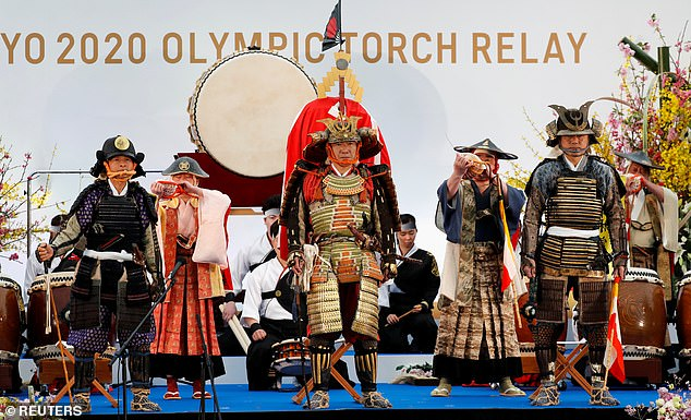 zdduring an opening performance on the first day of the Tokyo 2020 Olympic torch relay