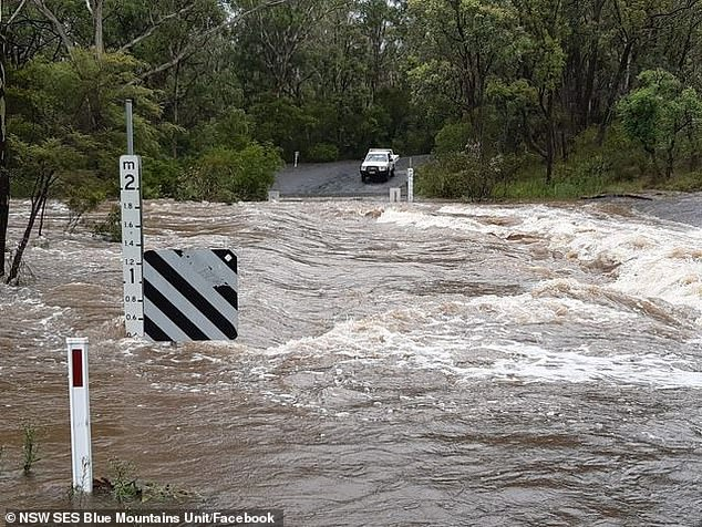 Megalong Road at Old Ford Reserve in Sydney Blue Mountain earlier this week as floodwaters raged through the area (pictured)