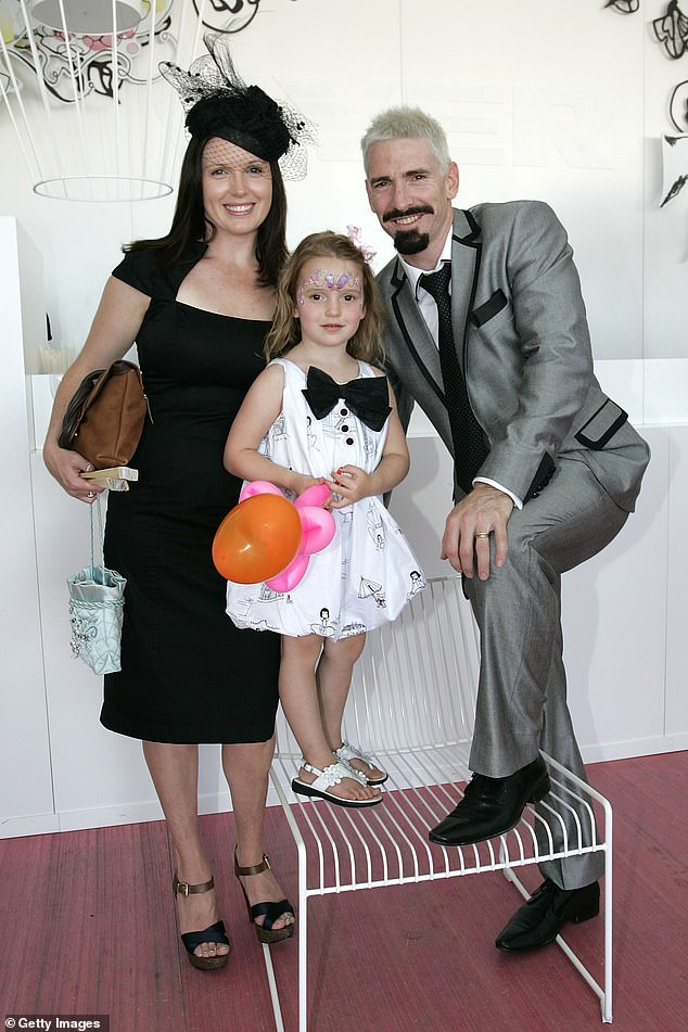 Akermanis poses for a picture at the races with wife Megan and daughter Charlotte in 2009. Now Charlotte is a part of the Brisbane Lions AFLW academy and getting some handy tips from her famous dad