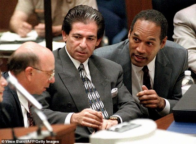 Legacy: Kim is following the footsteps of her late father - OJ Simpson (R) defense attorney Robert Kardashian Sr. (M, pictured in 1995) - who died, age 59, from esophageal cancer in 2003 when she was only 22