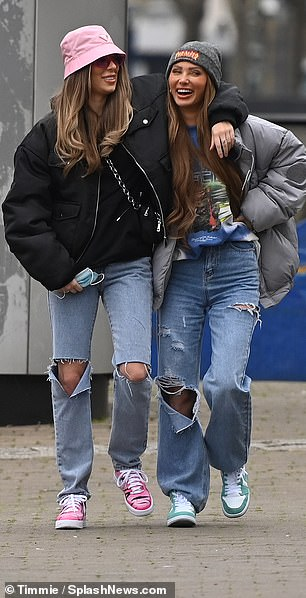 Picture of happiness: Demi rocked ripped denim jeans and a black padded jacket as she lovingly wrapped her arm around Francesca