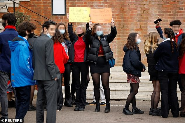 They were also understood to have stood in front of headmaster Adam Pettitt's office as a show of strength