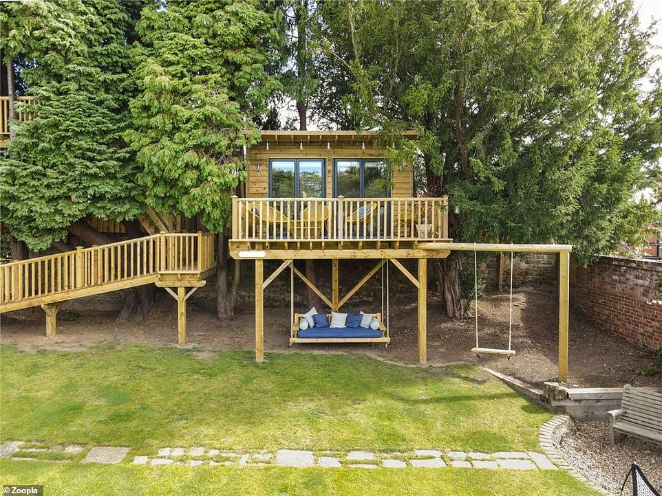 The Wakefield house has a tree house with a balcony overlooking the garden and several swings that hang from underneath