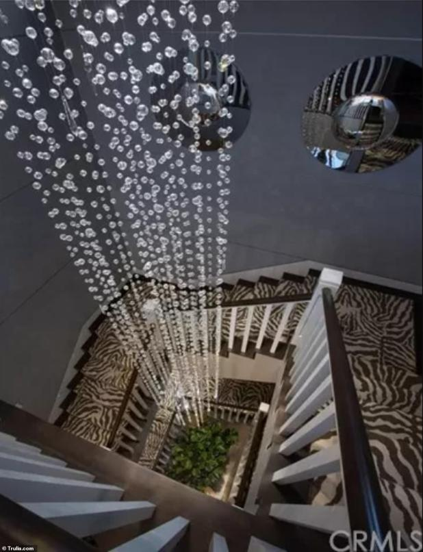 Gorgeous - A see-through bead arrangement runs across the center of the staircase, which is further embellished with zebra print rugs