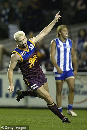 Akermanis celebrates a goal during when the Lions took on North Melbourne in Melbourne in 2004