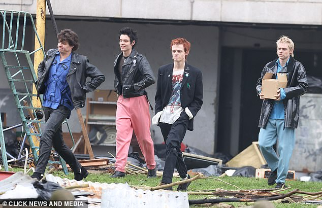 It's the Sex Pistols! Anson Boon, centre, transformed into Johnny Rotten as he joined his co-stars on set to film the hotly-anticipated show, Pistol, on Wednesday