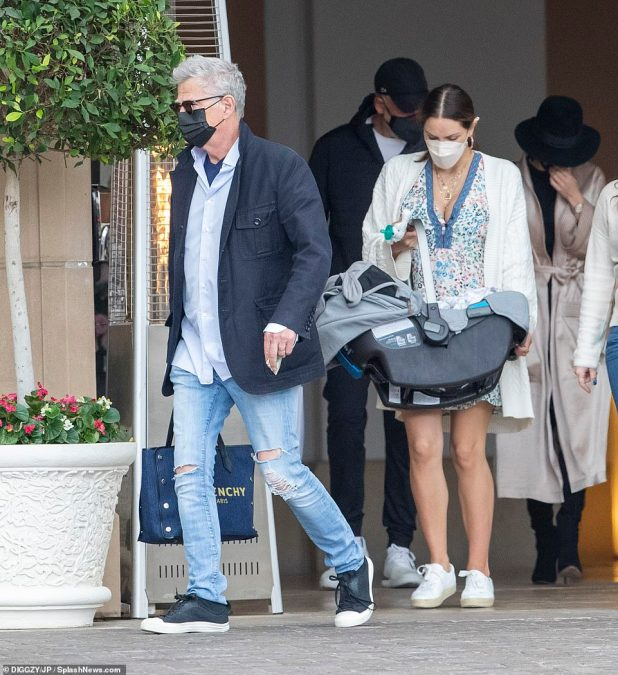 Arrival: Katharine and David were first seen arriving at the upscale establishment with Rennie safely stored in a padded baby carrier, which Katharine handled with ease.