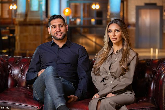 Amire Khan pictured left with wifeFaryal Makhdoom, right, revealed that he felt out of sorts for 28 hours after having the AstraZeneka jab, but told others in the BAME community to get it