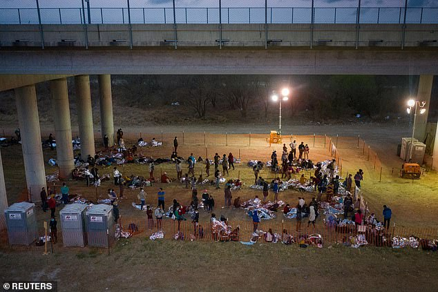 Asylum seeking migrant families and unaccompanied minors from Central America take refuge in a makeshift U.S. Customs and Border Protection processing center in Texas