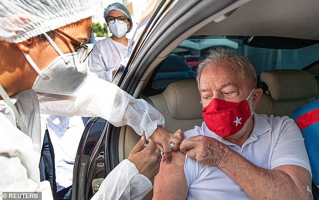 Former Brazilian President Luiz Inacio Lula da Silva receives a dose of the Sinovac's CoronaVac coronavirus disease (COVID-19) vaccine in Sao Bernardo do Campo near Sao Paulo, Brazil March 13, 2021