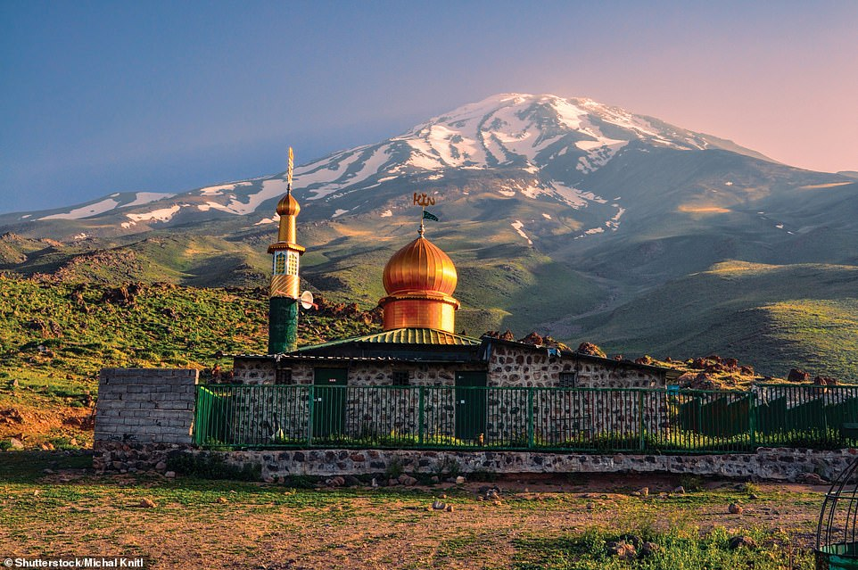 MOUNT DAMAVAND, IRAN: At 18,405ft (5,610m), Damavand is Asia's highest volcano. It first erupted almost 1.78million years ago, reveals Ford. He continues: 'After a number of eruptions around 600,000 and 280,000 years ago, which helped create its steep cone of ash and lava flows, Damavand's last one was around 5300 BC. The volcano is topped by a small crater and there are adjacent fumaroles, hot springs and mineral deposits, which imply Damavand could be considered as a potentially active volcano'