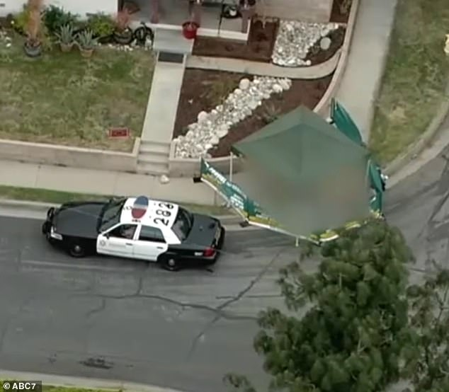 The woman's body was found outside the park, on the street, next to a house