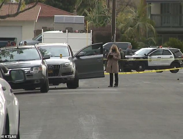 Police were seen interviewing neighbors in the street on Thursday while the suspect was in hospital