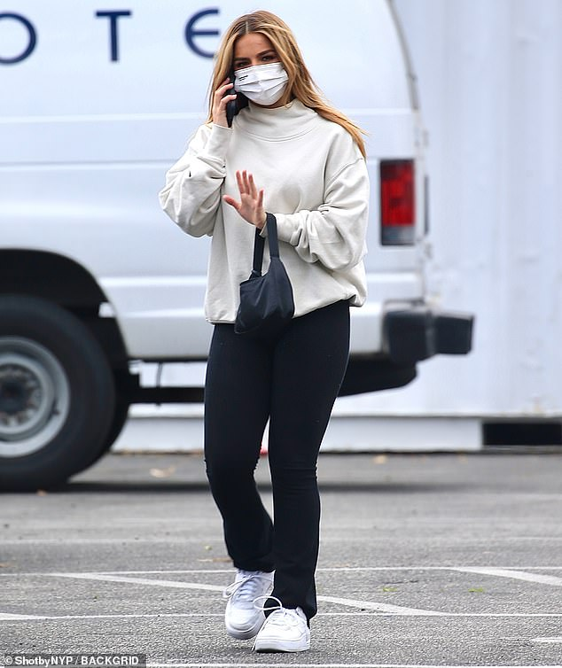 Staying safe: The TikTok personality wore a white facial covering to keep herself protected from COVID-19 while spending time in public
