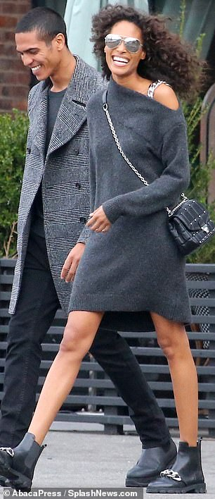 Shades of grey: Cindy skipped the color to sport a much darker look with a grey sweaterdress and black leather ankleboots