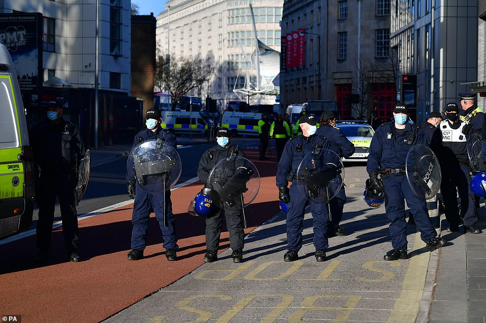 Officers stand guard in Bristol city centre, using manpower and vehicles to block the highway as demonstrators mass against thePolice, Crime, Sentencing and Courts Bill