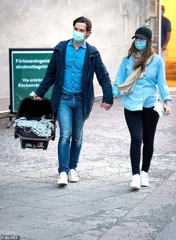 Sweden's Princess Sofia and Prince Carl Philip were seen leaving Danderyds hospital hand in hand after welcoming their third child together (pictured)
