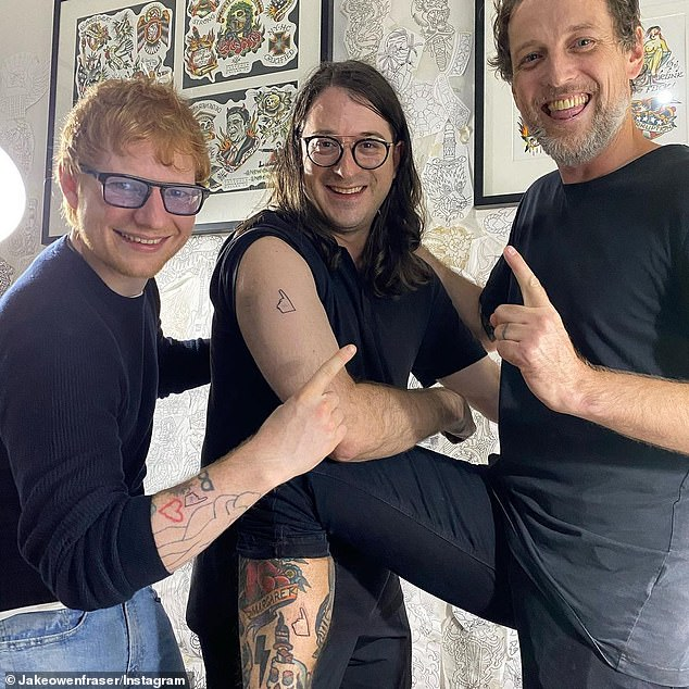 Permanent reminder: The day after the commemoration, Ed and Michael's son Matt (centre) - who has followed in his father's footsteps and is now the executive director of Mushroom Group - got matching tattoos in honour of the late Australian music icon