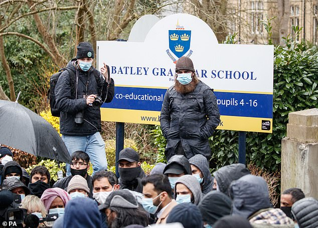Protestors gathered outside Batley Grammar School in West Yorkshire yesterday.On Thursday, the school 'unequivocally' apologised for showing 'totally inappropriate' material to children