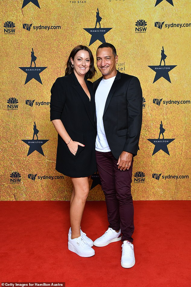 Matchy matchy:Celeste Barber went along with her husband Api Robin, the pair wearing matching black and white outfits. Both pictured