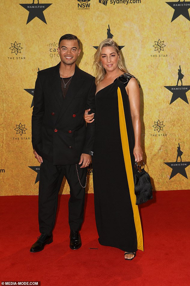 Stunner:Stylist Jules, 40, wore a one-shoulder dress with a dramatic yellow stripe along with strappy black heels